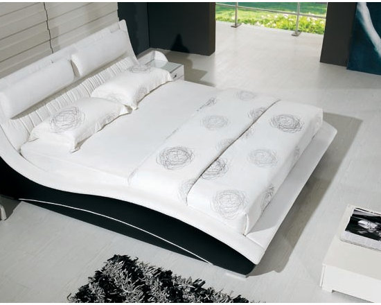 Quintessence Bed Frame - Ultra sleek contemporary style and genuine leather upholstery create the ultimate in fashionable modern bedroom decor in the Quintessence Modern Leather Bed Frame.