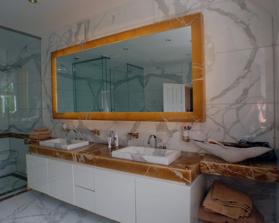 Marble Bathroom, Chislehurst - Large mirror with a back-lit honey onyx frame