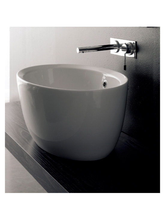 "Scarabeo - Beautiful Oval Shaped White Ceramic Built-In Sink by Scarabeo - Beautiful contemporary built-in oval shaped sink made of high quality white ceramic. Designed and manufactured in Italy by Scarabeo. Round bathroom sink includes overflow but has no predrilled faucet hole. Sink dimensions: 26.40"" (width), 11.80"" (height), 18.10"" (depth)"