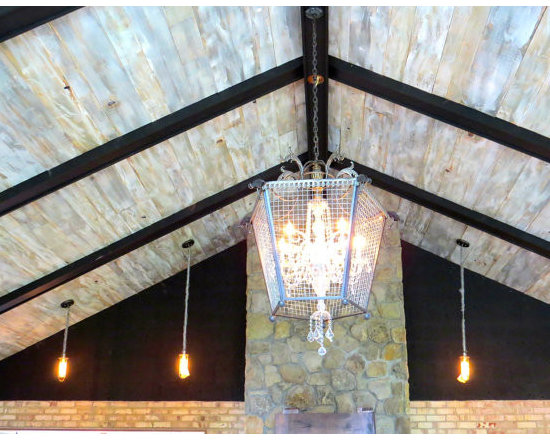 Antique Reclaimed & Old Growth Flooring - Did you ever sit and stare up at the sky until you were totally entranced by the clouds? Now you can enjoy that mesmerizing feeling anywhere in your home with our Cloud design ceiling planks. We start with a lightweight Eastern White Pine and mill it to 1/2 in. thickness. We bevel the edges and lightly sand the surface, taking care not to disturb any of the original character such as saw kerfs, etc. Our craftsmen then strategically finish with our special blend of gray, cream and white paints to mimic the sky on a cloudy day. With the right lighting, our Cloud design ceiling panels will captivate your family and friends!