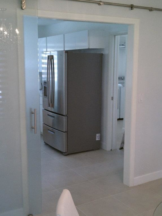 Barnyard Style Sliding Doors - Custom made Barnyard Style Door with Acid Etched Glass in the open position ~ separating the kitchen and dining room