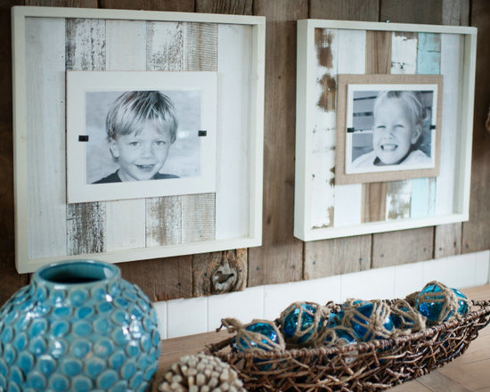 Reclaimed White Wash Wood Frames - Now available in a Cape Code style white wash -our reclaimed frames crafted of weathered and painted wood have a cream colored interior frame to feature your favorite photos. Easy front loading, clamping system under Plexiglas makes photo updates a breeze. Available in four styles.