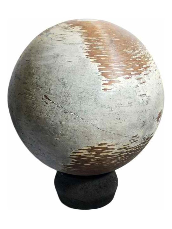Industrial Wood Sphere - An industrial Wood sphere on stone stand. Must have been used in a workshop due to the worn circular patterns. The surface contains wonderful wear and patina.