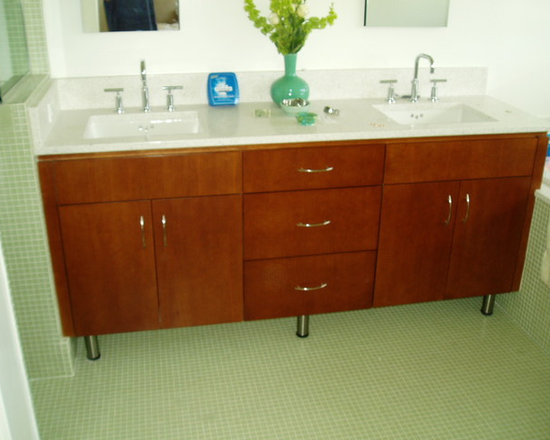 European Style Bathroom Cabinets - This European style cherry bathroom cabinet is sleek in design, from the flat slab doors and drawer fronts to the steel legs at the bottom.  Fabulous!  Please visit our web site to see more photos of this cabinet as well as many more.