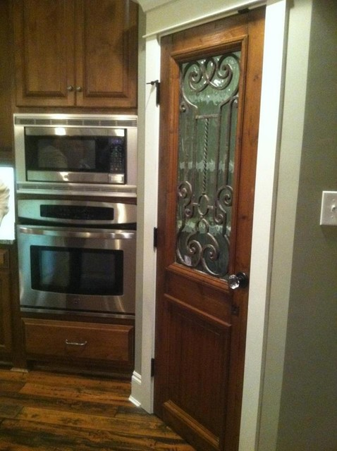 Antique door used as kitchen pantry door  kitchen cabinets