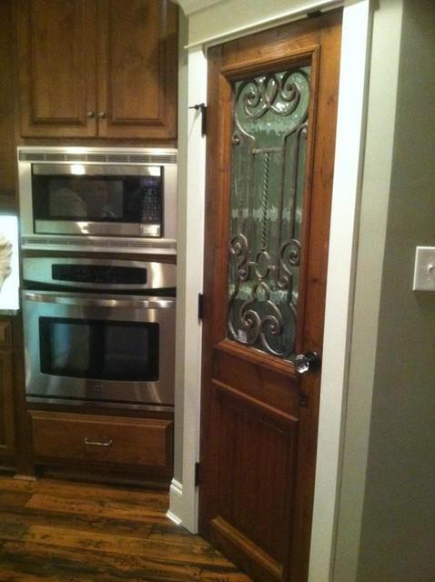 Antique door used as kitchen pantry door