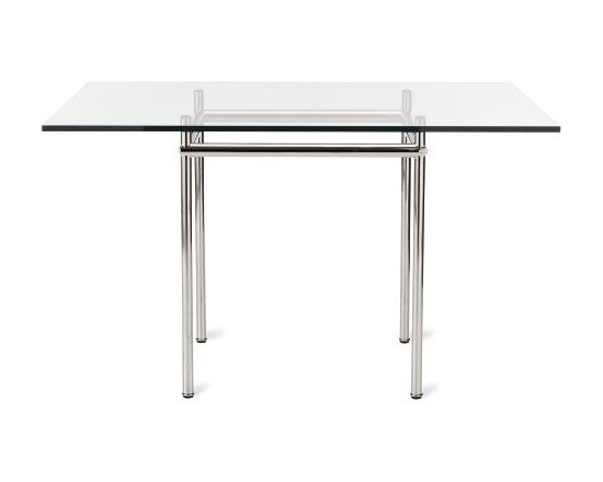 """Cassina - LC12 La Roche Table - Le Corbusier designed his LC12 Table (1925) for Villa La Roche in Paris. The structure, which is a pair of semi-attached houses, was Corbusier's third commission in Paris and today it houses the Foundation Le Corbusier. The house, which Corbu and his cousin Pierre Jeanneret designed for a Swiss banker and art collector, is a series of small spaces that explode into larger rooms and the experience culminates with a curved two-story gallery. It is an example of what Corbusier referred to as """"new"""" architecture, which he described as """"the clever, accurate and magnificent play of volumes assembled with light."""" The LC12 Table reflects this, but in a simpler scale. The pedestal is of a minimal width for its vertical shape, and the tabletop has maximum width for its minimal horizontal dimension. Each piece is signed and numbered and, as a product of Cassina's Masters Collection, is manufactured by Cassina under exclusive worldwide license from the Le Corbusier Foundation. Made in Italy. The user-friendly size of the LC12 makes it easy to fit into any space for use as a desk or dining table. Fits up to four people comfortably."""