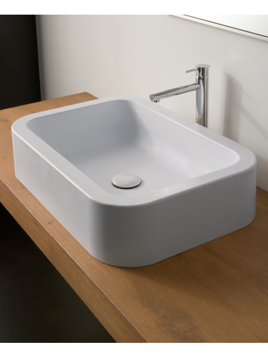 "Scarabeo - Modern Deep Rectangular Ceramic Vessel Sink by Scarabeo - Modern style white ceramic bathroom sink without overflow. Rectangular and curved above counter vessel sink   has no predrilled faucet holes. Designed and manufactured in Italy by Scarabeo. Sink dimensions: 23.60"" (width), 4.30"" (height), 16.00"" (depth)"