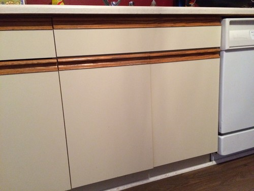 Outdated cabinets Looking for ways to spruce up the doors without