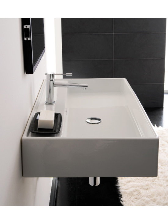 "Scarabeo - Rectangular Wall Mounted or Vessel Bathroom Sink by Scarabeo - This beautiful contemporary sink is made of white ceramic and includes overflow. Sink is available with single faucet hole (as shown), no hole, or three holes. It can be installed as either a wall mounted sink, or an above counter vessel style sink. Made in Italy by Scarabeo. Sink dimensions: 31.50"" (width), 5.70"" (height), 18.10"" (depth)"