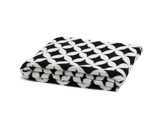 Eco Reversible Trellis Throw-Black/Milk - With its diamond trellis motif and bold graphic appeal, this throw blanket in Black/ Milk is a great addition in any room in your home. Try using it at the end of a bed or thrown over a comfy chair to up the style quotient in your room.