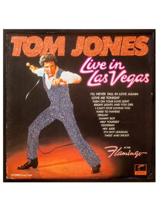 "Glittered Tom Jones Live in Las Vegas Album - Glittered record album. Album is framed in a black 12x12"" square frame with front and back cover and clips holding the record in place on the back. Album covers are original vintage covers."