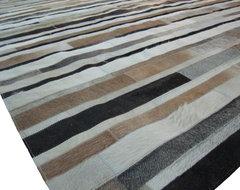Cowhide Patchwork Rug in Strips of Cream, Grey, and Beige modern-rugs