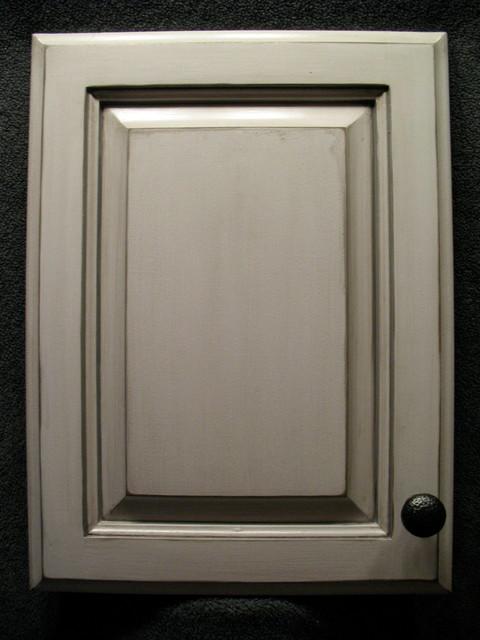 Grey antiqued cabinet door. Glazing applied.