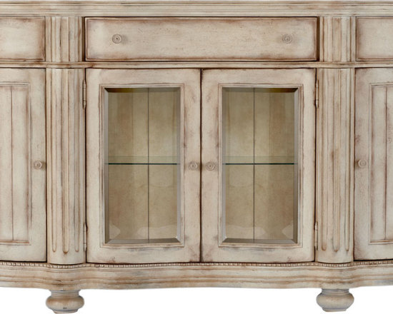 Tabitha Sideboard - Handcrafted of pine and pine veneers in a linen finish. Six doors, one drawer, and three shelves. Built-in light uses one 20-watt bulb.