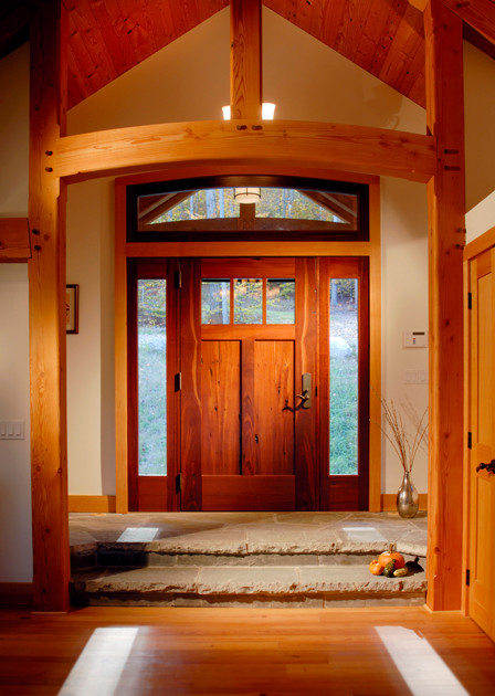 Custom wooden entry door in timber frame home for Large wooden front doors