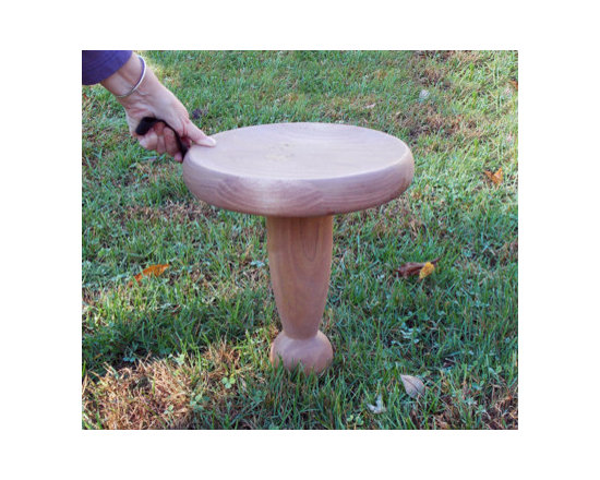 Pivoting Garden Stool - Based on the traditional one-leg milking stool. Seat is dished so you don't slip and the large ball underneath lets you turn in any direction, without getting up. Carrying strap included.