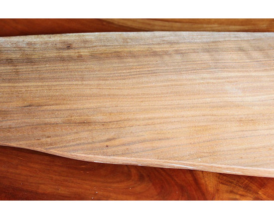 Natural Edge Serving Boards: Butternut - 60nobscot's Serving Boards from shop scraps & cut-offs are chosen for the character of their grain, figure, shape and color making them perfect for serving Sushi, Cheese, Bread or any other use that demands a striking presentation. They are all on felt covered feet to allow them to be scratch free on other fine surfaces.