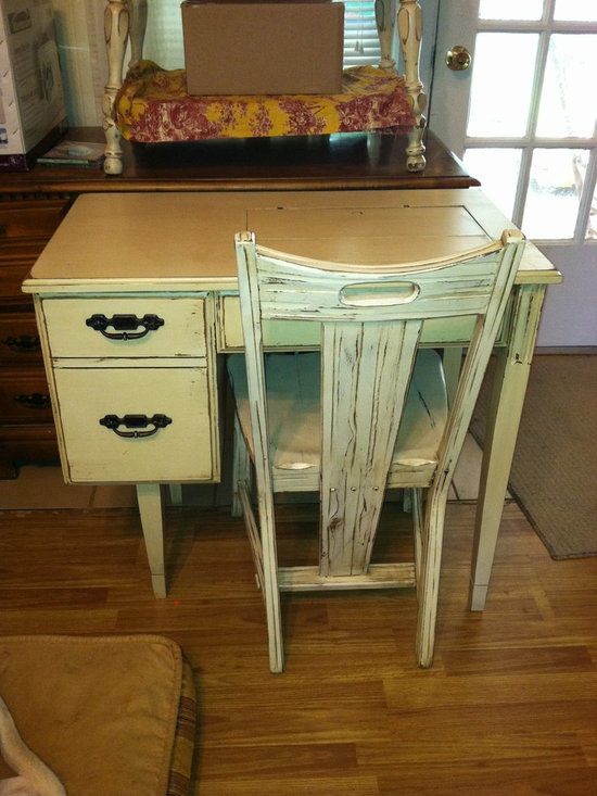 Accent tables - An old sewing machine table was given new life by fixing the top closed yet keeping the character of the table. A unique small chair from the 60's paired well with this great find. by Jennifer Beckham