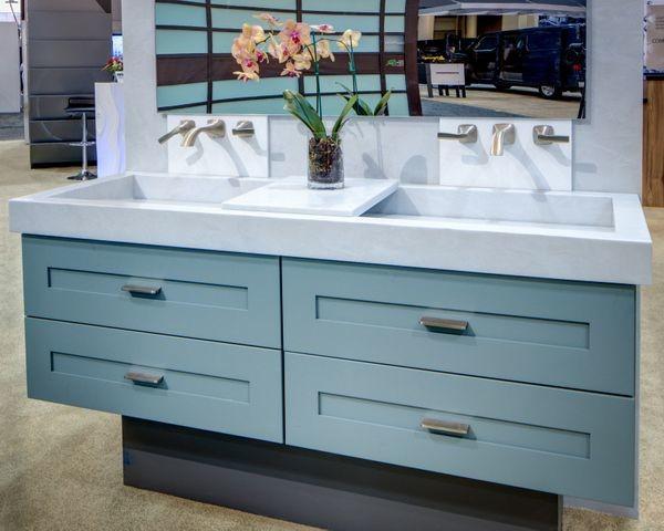 Corian Seafoam display contemporary bathroom vanities and sink consoles