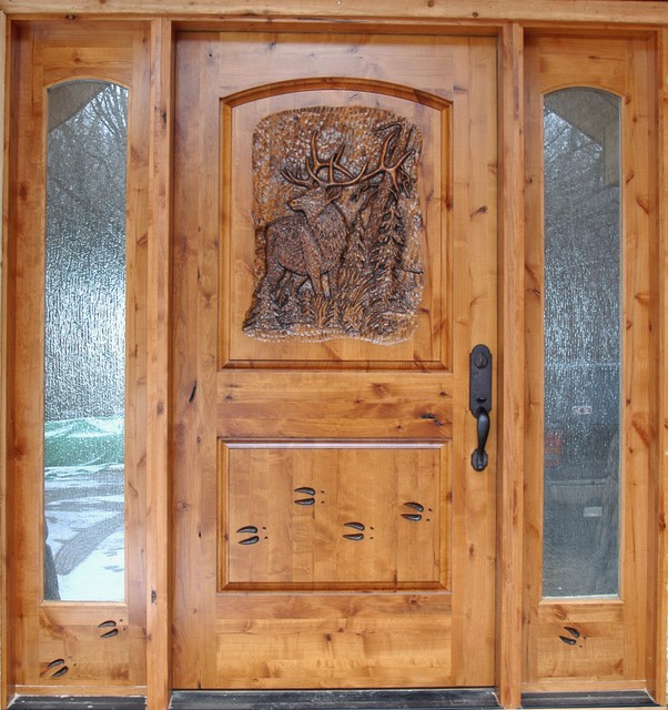 Knotty alder entrance with hand carved door front doors for Door design houzz