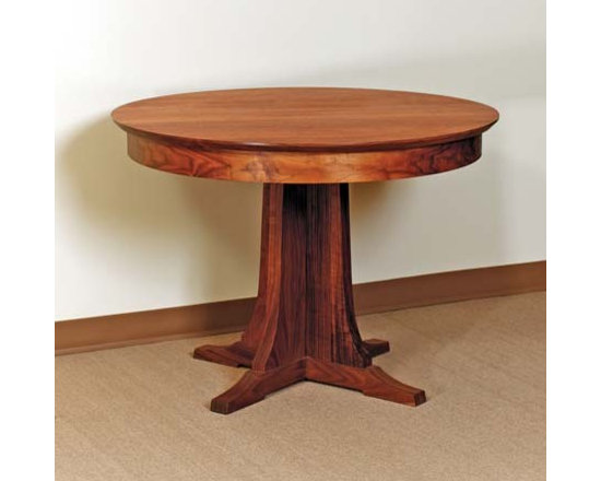 PEDESTAL ROUND DINING TABLE - The pedestal table was conceived as early as the 18th Century with supports located closer to the tables center, than the traditional style of being around the tables edge. This new concept was in demand in high society of the time due to its price and novelty. Just as popular today, our pedestal and double pedestal dining tables are at home in the center of your gathering, with modest, sweeping pedestal bases and refined, yet elegant solid wood tops. Steeped in rich history with a nod to today's lifestyles, these tables fit in any style home.