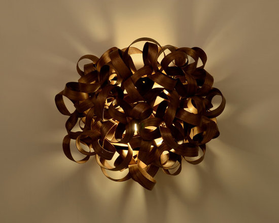 Eco Friendly Furnture and Lighting - the Flock Light, delicately hand crafted out of steam bent FSC Sycamore wood to create a stunning and unique lighting effect. Includes an E27 ES wall mountable bulbholder to be used with a small low energy bulb (Max 20 Watt) and wall fixing kit. Designed to be easily installed on to an interior wall Materials: FSC Certified Sycamore Laser cut Birch Ply