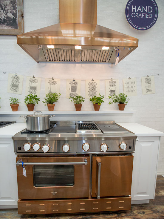 """48"""" BlueStar Range in Infused Copper - Showcasing a 48 Inch BlueStar Gas Range in Infused Copper from our Precious Metals Collection featuring a griddle, charbroiler, frenchtop, and 2 burners with beautiful white knobs"""