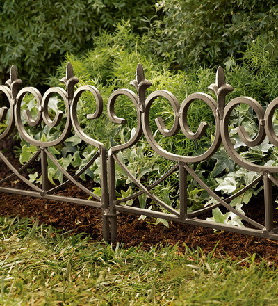 Fleur de lis edging traditional home fencing and gates by plow