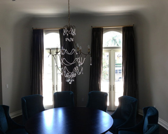 Drapery Ideas - These silk panels actually function on a decorative traverse rod.  They are simply beautiful.