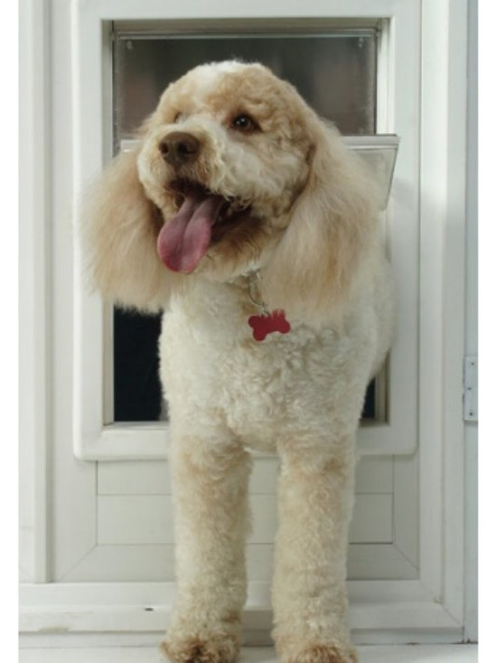 Ideal - Ideal Multi-Flex Storm Door Dog Door Multicolor - MFM - Shop for Pet Doors from Hayneedle.com! Now your dog can chase bunnies anytime he wants. Our Ideal Multi-Flex Dog Door allows your dog to enter and exit your home as he wishes. It's constructed of sturdy thermoplastic (ABS) with an inner telescoping frame and it allows easy secure installation. Dual-pane LEXAN hard panels have an air gap in-between and the flap design prevents ears paws and tails from becoming trapped. The spring-loaded locking slide enables one-handed use and insulation for maximum energy efficiency means that you won't lose warm air in the winter and cool air in the summer. The dog door is available in medium or extra large size to accommodate your favorite pup. Limited lifetime warranty. See below for dimensions.Medium Dog DoorOverall dimensions: 10W x 2D x 15H inchesFlap dimensions: 6.625W x 11.25H inchesHole dimensions: 8.875W x 13.5H inchesSuggested pet weight: Up to 35 lbs.Extra Large Dog DoorOverall dimensions: 13.5W x 2D x 18.5H inchesFlap dimensions: 10.25W x 15.75H inchesHole dimensions: 11.75W x 17.375H inchesSuggested pet weight: Up to 90 lbs.Note: Look for the template included with your pet door and be sure to use it. Consider your pet's weight and size and position the template accordingly. This will ensure a correct installation the first time.About Ideal Pet Products Inc.In the beginning a hole an old piece of carpet and a couple of nails created the first access for your pet to go in and out. But there were drawbacks. It didn't stay closed well. Your pet couldn't see through it. And when it got wet it didn't smell so good. Enter technology.For more than 25 years Ideal Pet Products has assisted pet owners by offering unique and ingenious ways of providing indoor/outdoor access to their pets. The company provides various styles of pet access doors so you're sure to find one that meets your specific needs. Ideal Pet Products is also committed to conserving natural resources by designing products that are sensitive to your energy-saving needs. From the smallest dog or cat to the largest 160-lb. pet Ideal Pet Products has the right door for your home.