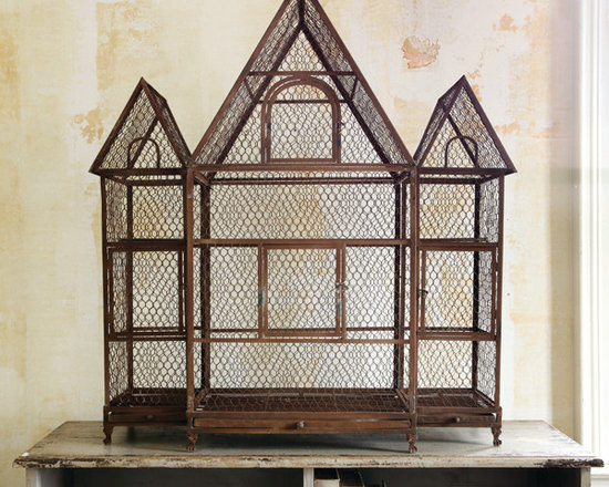 """Three Gable Birdcage - Our magnificent antique-inspired birdcage palace is an eye-catching work of art as well as a wonderfully versatile accessory. Consider the addition of groupings of candles for intimate evening lighting, or attractive florals and potted plants in the daytime. Roomy Victorian design is constructed in sturdy wire and metal, with pull-out trays and hinged doors for convenience. A home and garden collection selected that bring happy memories of childhood past. Whether you are looking for period charm, a style of elegant restraint or just want to infuse a spirit of playfulness, you'll find it here. Dimensions: 43""""w x 17""""s x 45.5""""h"""