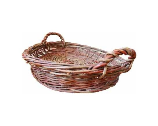 Oval Woven Rattan Basket - Hand-woven from thick strands of rattan, this charming basket has a rustic look and reliable strength. It is generous in size and has twisted-rattan handles, making it perfect for organizing and toting anything from blankets to pillows to firewood.