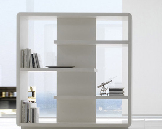 Surface bookcase - Available in glossy or matt lacquered MDF in one or two colours with the center vertical panel contrasting with rest of the structure. The center panel can also be in Leccese stone.