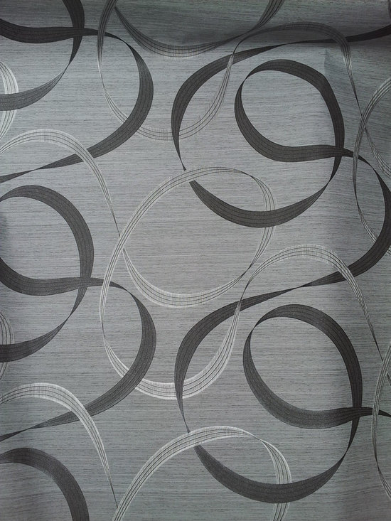 Wallcoverng that can Give you some Punch! - Swirls in blacks, grays, and whites will give your space an amazing look.  Will compliment stainless steel appliances.