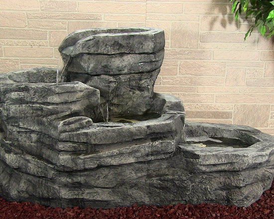 Outdoor Classics - Cascading Brook Fountain with LED Lights - The Cascading Brook belongs in a long flower bed or bed of mulch where it can stand out as the main centerpiece of the area.  It really looks great at night as well with the glowing underwater lights it features.