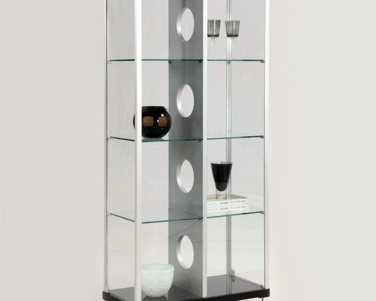 Chintaly - Chintaly Phoenix Modern Locking Glass Curio Cabinet Multicolor - 6603-CUR - Shop for China from Hayneedle.com! Add a touch of geometric interest to any room with this Chintaly Phoenix Modern Locking Glass Curio Cabinet. Equipped with tempered glass shelves your curio cabinet features two side doors with locks for stylish and functional storage. Two built-in lights showcase your favorite pieces in style. The center divider is complete with ultra modern circular cut-outs. About Chintaly Imports Based in Farmingdale New York Chintaly Imports has been supplying the furniture industry with quality products since 1997. From its humble beginning with a small assortment of casual dining tables and chairs Chintaly Imports has grown to become a full-range supplier of curios computer desks accent pieces occasional table barstools pub sets upholstery groups and bedroom sets. This assortment of products includes many high-styled contemporary and traditionally-styled items. Chintaly Imports takes pride in the fact that many of its products offer the innovative look style and quality which are offered with other suppliers at much higher prices. Currently Chintaly Imports products appeal to a broad customer base which encompasses many single store operations along with numerous top 100 dealers. Chintaly Imports showrooms are located in High Point North Carolina and Las Vegas Nevada.