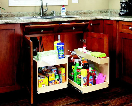 Pull Out Shelves with Risers - Custom pull out shelves with risers provide additional storage for your undersink cabinets.  Risers fit around the plumbing that sits inside your undersink cabinets.