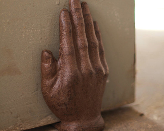 Cast Iron Hand Door Stop - Just talk to the hand! It sits on command and politely holds the door. And think of the Halloween possibilities! Perhaps you should purchase more than one. Cast iron, rustic finish.