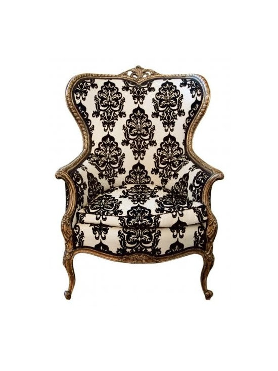 The Wing Chair - This exquisite armchair that is beautifully ornate, would be a perfect armchair for a traditional setting. Adding that bit of grander any space needs.