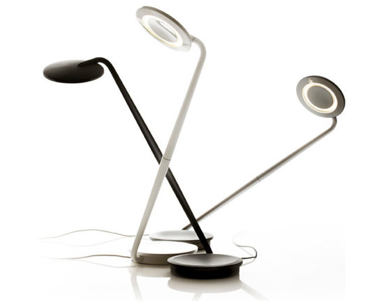Pablo Designs - Pixo LED Desk Lamp (7 colours) - Pixo's swiveling light shade and highly maneuverable arm lend it maximum utility within a minimal footprint. Its compact, energy-saving LED light is infinitely adjustable, allowing the user to focus warm, glare-free light wherever needed. The base integrates a USB port for charging mobile devices. Even more, the upper and lower pieces ship detached from one another to reduce packing materials and shipping costs. Pixo is 97% recyclable.