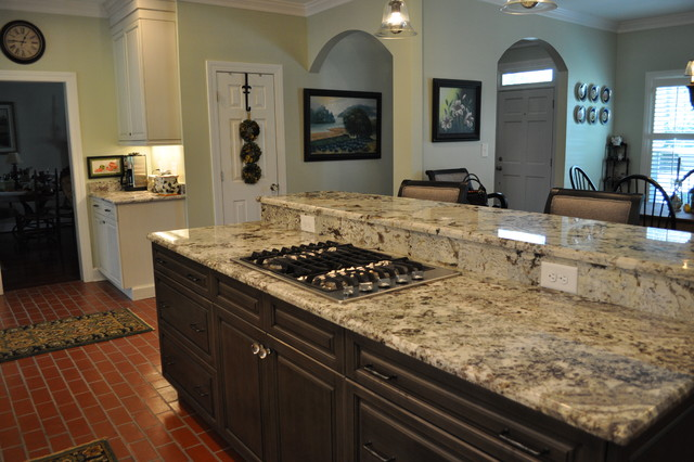 Brush-stroke painted kitchen with red brick floor
