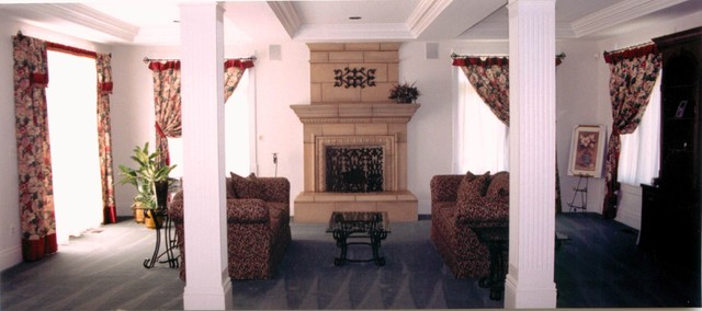 Family Room w/ Tuscan Stone Fireplace mediterranean-window-treatments