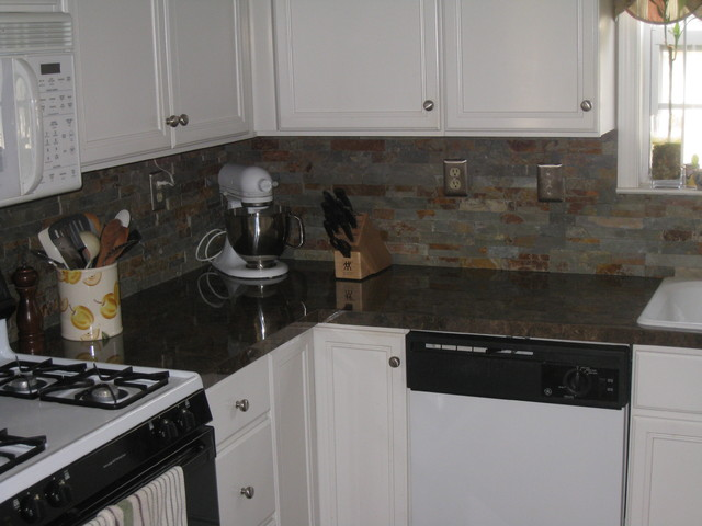 new formica countertops and natural stone backsplash
