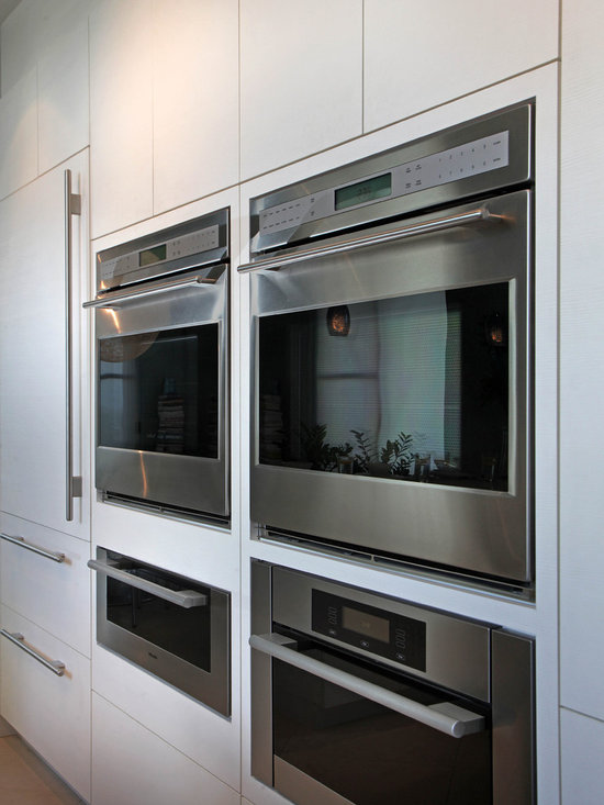 Kitchen in Sarasota - Flush inset appliance installation. Double ovens, steam oven, and warming drawer.