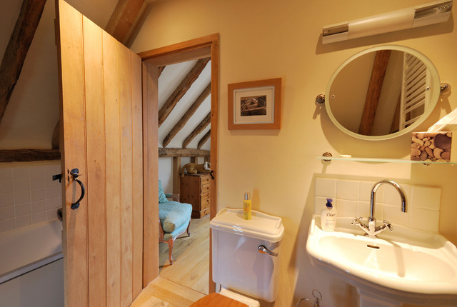 Barn conversion in kent uk rustic bathroom london for Barn conversion bathroom ideas