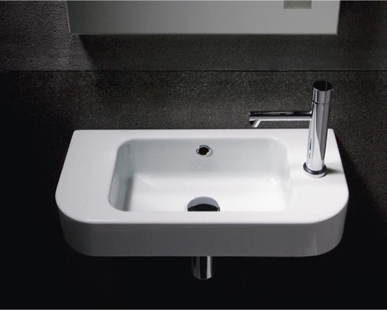 "GSI - Simple Rectangular Wall Mounted Sink with Curved Front by GSI - This white ceramic bathroom sink with contemporary design is made in Italy by GSI. Wall mounted sink includes overflow and has option for no faucet hole or single faucet hole (as shown)(left side or right side). Sink dimensions: 21.70"" (width), 5.90"" (height), 10.80"" (depth)"