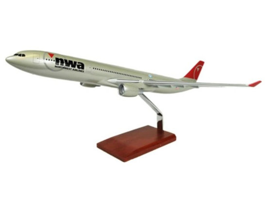 Toys and Models - A330-300 Northwest Multicolor - KA330NWTR - Shop for Model Kits from Hayneedle.com! Developed in the early 1990s the Airbus 330 is a very versatile aircraft that operates as a medium- and long-range airliner as well as serving as a freighter jet with an additional military mid-air refueling tanker variant available. A Northrop-Grumman derivative of the A330 tanker variant designated the KC-45 won a U.S. Air Force contract a rarity for a non-American built modern aircraft. While the contract was later canceled a number of militaries around the world use the A330 MRTT tanker and transport version. The aircraft modeled here is the A330-300 a newer model introduced in 1993 that can carry anywhere between 295 and 440 passengers depending upon layout. It is presented here with a finely detailed Northwest Airlines paint scheme and its high quality construction will make it a welcome addition to any collection.