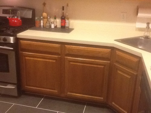 Trying to update oak cabinets with black hardware. Just did floors and ...