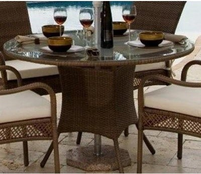 Put dinner - and dining design - on a pedestal with the Hospitality Rattan Grena modern dining tables